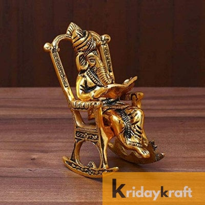 Lord Ganesha on Chair Reading Ramayan Metal Handicraft Figurine with Gold Plated