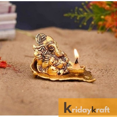 Ganesha sitting on leaf with diya gold plated for home decor