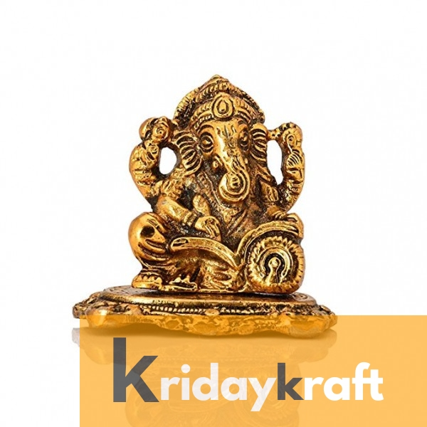 Ganesha sitting and reading book smal size gold plated for home decor and gifts