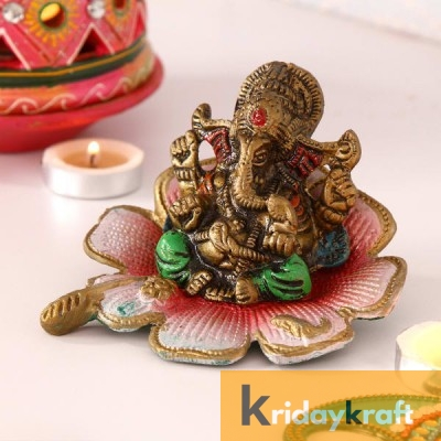 Ganesha sitting on flower red color for home decor and gifts