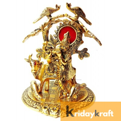 Krishna with kamdhenu cow standing under tree and playing flute gold plated