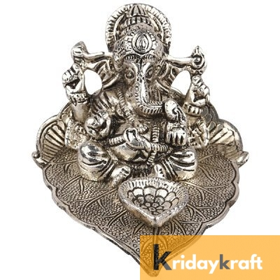 Ganesha sitting on leaf with diya Silver plated for home decor